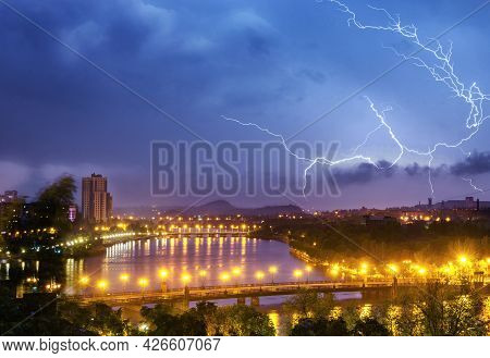 Thunderstorm With Lightning Over Night City Sky.