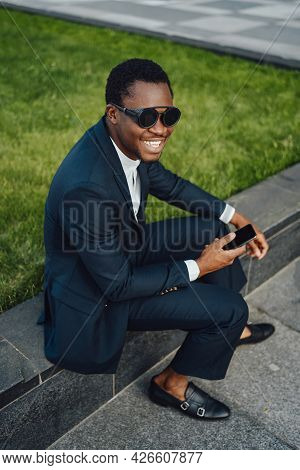Smiling Businessman Of African Descent With Mobile Phone
