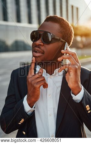 Cool Business Person Of African Descent With Phone