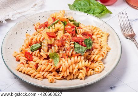 Marinara Pasta In A Plate Close-up, High Key - Vegetarian Girandole Pasta With Tomato Sauce And Fres