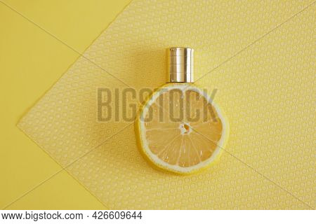 Citrus Scent, Perfume With Lemon Scent Concept, Lemon With Spray Bottle On Yellow Background