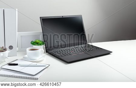 Office Pc Desk Workspace In Home Interior. Long Web Banner. White Table With Laptop For Remote Work