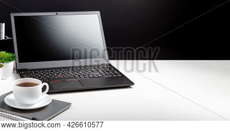 Modern Minimal Workplace For Man With Copy Space. Home Office Laptop Screen Blank Display Workspace.
