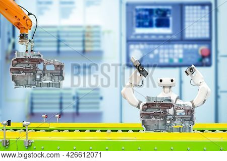 Industrial Robotic Teamwork Working With Auto Parts Via Conveyor On Smart Factory, On Blurred Contro