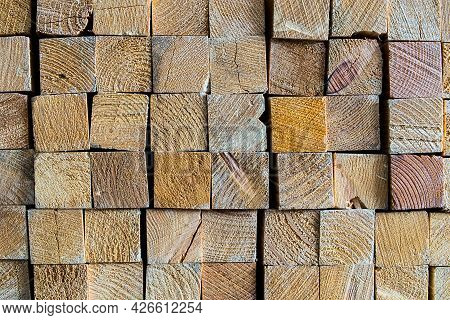 Industrial Heads Wood Of  Of Sawed Timber Material That Are Stacked In A Square On Wood Warehouse St