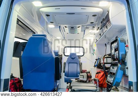 Inside An Ambulance Car With Medical Equipment For Helping Patients Before Delivery To The Hospital