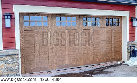 Pano Brown Door With Glass Panes Of Two Car Residential Garage In Snowy Neighborhood