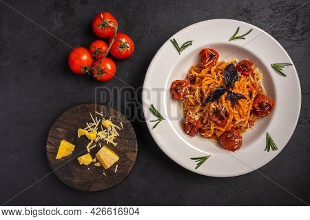 Pasta With Baked Cherry Tomatoes, Grated Parmesan And Pesto Sauce On Dark Graphite Background, Top V