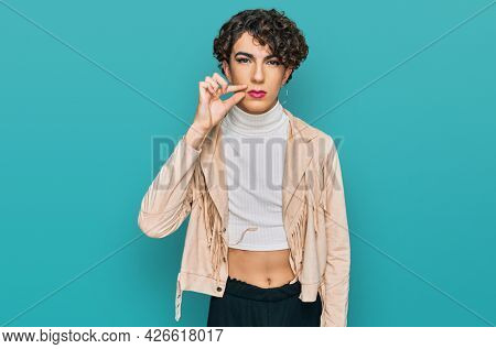 Handsome man wearing make up and woman clothes mouth and lips shut as zip with fingers. secret and silent, taboo talking