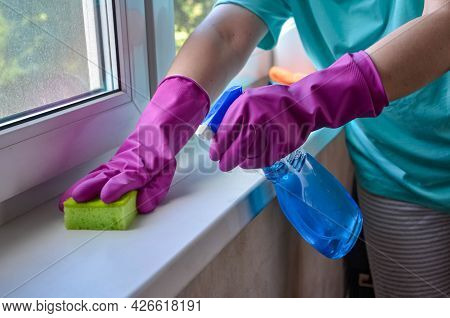 Washing Windows. Female Hands In Gloves Hold Spray Bottle With Glass Cleaner And Sponge. Woman Washe