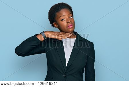 Young african american girl wearing business clothes cutting throat with hand as knife, threaten aggression with furious violence