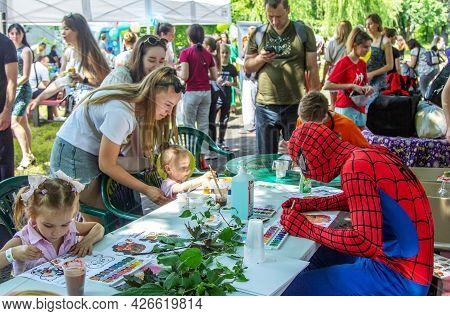 Zaporizhia, Ukraine- June 19, 2021: Charity Family Festival:  Children, Parents And Volunteer, Dress