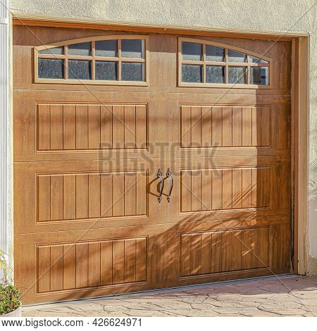 Square Brown Glass Paned Wooden Garage Door Of Home In Huntington Beach California