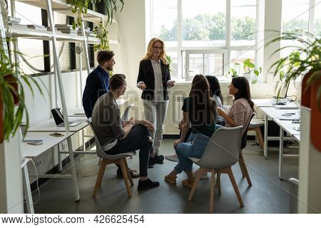 Mature Presenter Giving Consultation To Team Of Managers