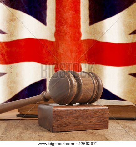 Wooden gavel and vintage England flag poster
