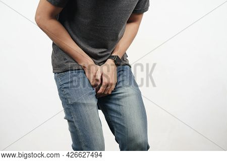 Young Man Holding His Crotch Suffering From Diarrhea, Incontinence, Prostatitis, Venereal Disease. H