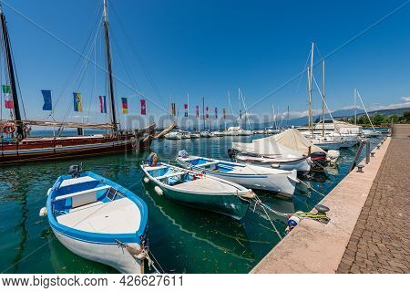 Port Of The Small Bardolino Village With Many Moored Boats, Tourist Resort On The Coast Of Lake Gard