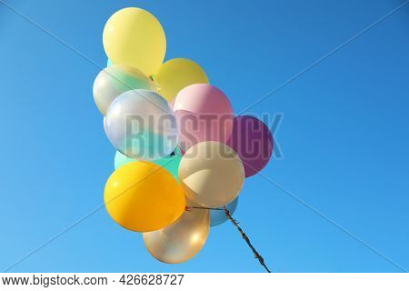 Many Sunlit Bright Balloons In Blue Sky