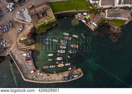 Coverack, Cornwall, Uk - June 29, 2021.  Aerial View Of The Picturesque Harbour Of Coverack In Cornw