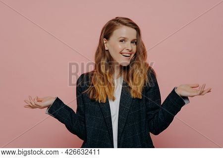 Happy Attractive Young Woman With Thick Medium Length Ginger Hair Wearing Dark Formal Jacket And Whi