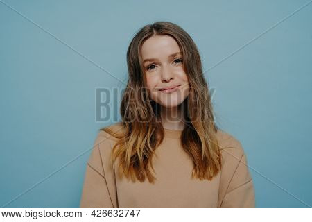 Photo Of Pretty Smiling Teenage Girl Without Makeup Looking At Camera Wearing Comfortable Light Brow
