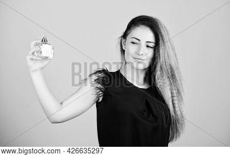 Inevitable. Girl With Bottle Of Perfume. Feel Extraordinary. Woman With Bottle Of Perfume. Girl Appl