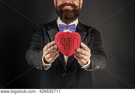 Heart In Hands Of Happy Tuxedo Man. Happy Valentines Day. Be My Valentine. Love And Romance.