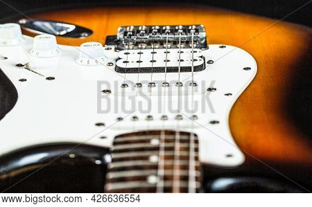 Close Up Of Music Guitar. Stringed Electric Musical Instrument. Musical Instrument For Rock, Blues,