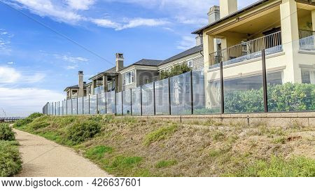 Pano Houses Overlooking A Pathway With View Of The Sea In Huntington Beach California