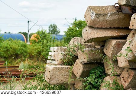 Old No Longer Used Overgrown And Discarded Railroad Sleepers In A Storage Yard