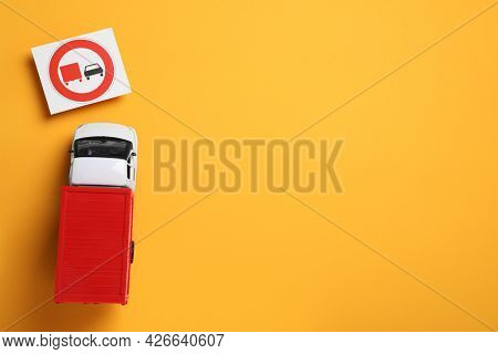 Toy Lorry And Road Sign No Overtaking For On Yellow Background, Flat Lay