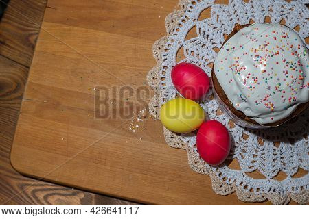 Traditional Easter Cake And Colorful Easter Eggs On Wooden Background. Easter Concept.