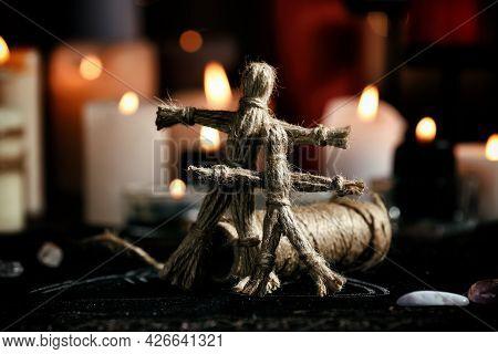 Voodoo Dolls On Table In Dark Room. Curse Ceremony