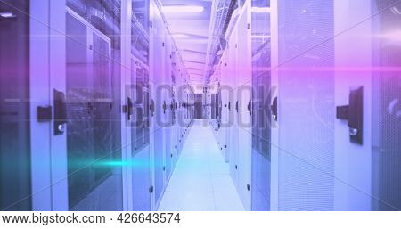 Image of glowing horizontal lines processing information flowing over network of computer servers in server room. global network of internet service provider, data processing centre concept.