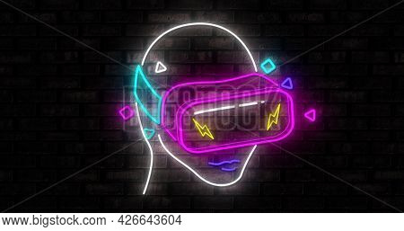 Image of a retro multicolor neon human head with virtual reality mask flickering with yellow flashes on black background. digital technology and entertainment concept digitally generated image. 4k
