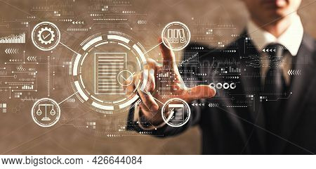 Compliance Concept With Businessman On Dark Vintage Background
