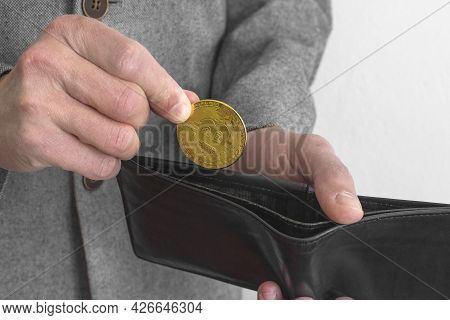 Businessman Wearing A Suit, Holding A Wallet And A Bitcoin Btc Crypto Currency Gold Coin, New Virtua