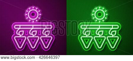 Glowing Neon Line Drying Grapes Icon Isolated On Purple And Green Background. Dried Grapes. Vector