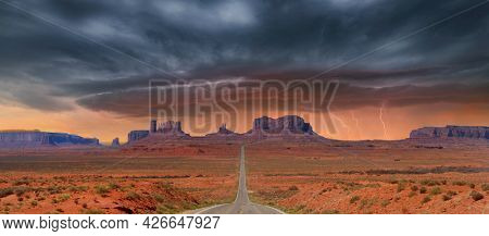 Landscape approaching Monument Valley in Utah at mile marker 13 during a lightening storm.