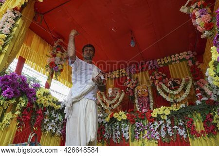 Howrah, West Bengal, India - 7th July 2019 : Hindu Priest Worshipping Idol Of God Jagannath, Balaram