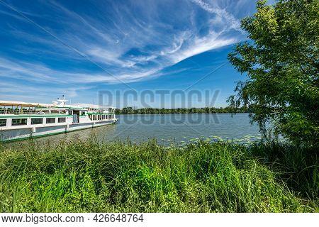 The Mantua Lake (lago Di Mezzo) Or Mincio River With A Moored Ferry Boat In Springtime. Mantova, Lom