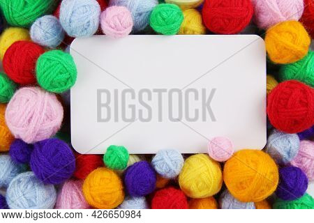 Colored Balls Of Yarn For Knitting, Crocheting With An Empty Space For Text In The Middle.handmade C