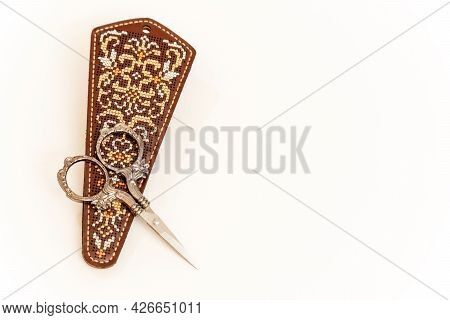 Case For Nail Scissors. Embroidery With Threads On The Skin. Handmade Work. The Color Is Brown. The