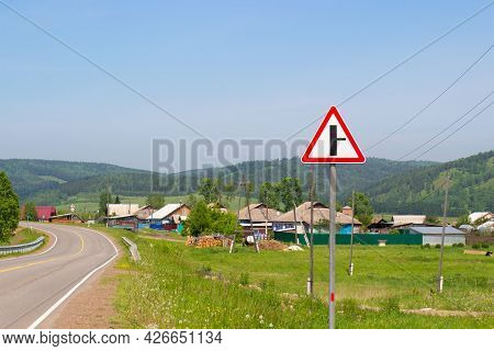 Summer Landscape Of Russian Village Along The Road In Siberia