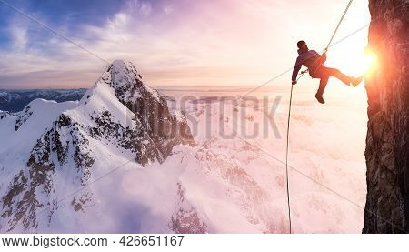 Epic Adventurous Extreme Sport Composite Of Rock Climbing Man Rappelling From A Cliff. Aerial Mounta