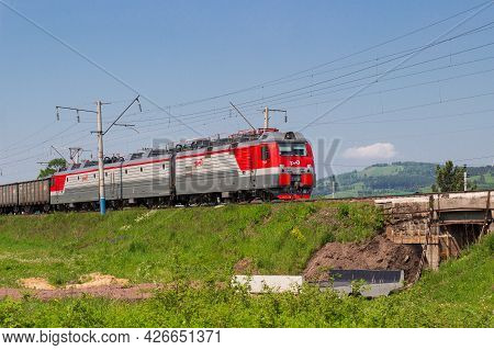 Krasnoyarsk, Russia - June 20, 2021: Red And Grey Freight Train Or Locomotive With Of Rzhd Logo On T