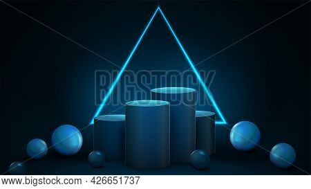 Empty Blue Winners Cylindrical Pedestals With Large Neon Triangular Frame On Dark Background And Dec