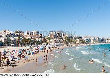 Villlajoyosa Spain - August 25 2016; Crowded Beach In Summer Mediterranean Scenes Holiday Makers Sun