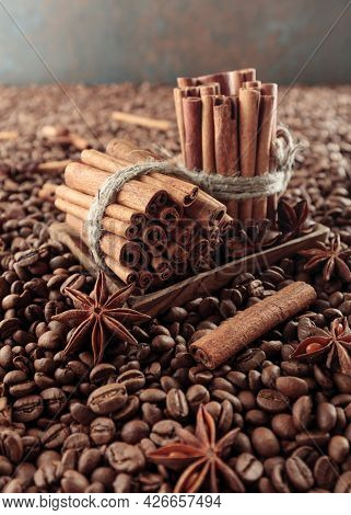 Roasted Coffee Beans With Anise And Cinnamon Sticks.