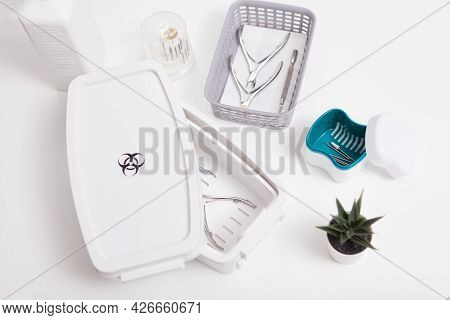 Top View Shot Of Manicure Instruments Sterilizing In Disinfection Box